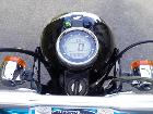 It attached to the ape 100. Although tachometer wa...